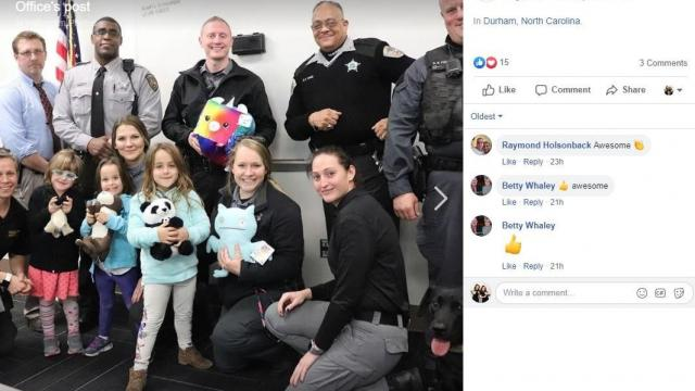 Twin girls give toys to kids in need