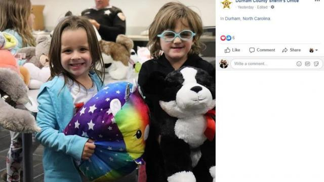 Twin sisters Ella and Claire brought toys to the Durham County Sheriff's Office.