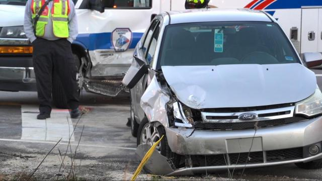 Crash between EMS vehicle and car