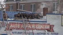IMAGES: Car repair shop in downtown Durham damaged in fire