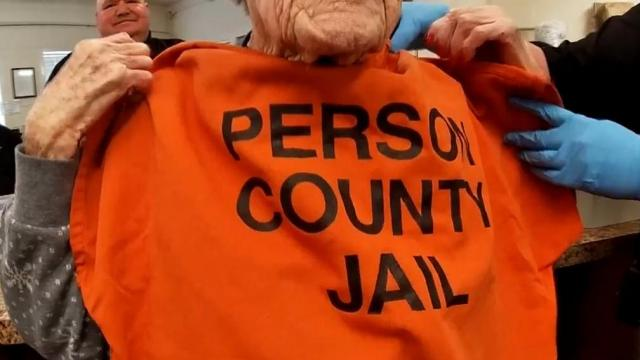 For her 100th birthday she got an orange Person county jail shirt