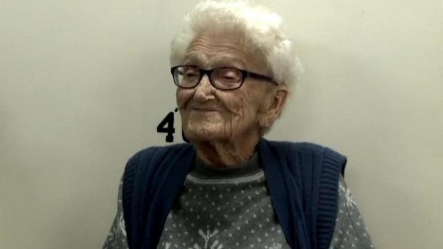 100-year-old Ruth Bryant smiles for her jail portrait