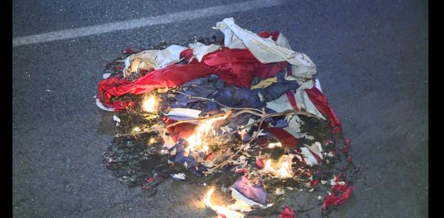 American flag burned during protests in downtown Raleigh