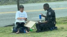 IMAGE: 'Touched by an angel': Goldsboro police officer eats lunch with homeless woman
