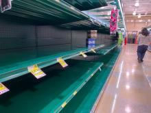 Latest: Local grocery shelves empty as virus totals hit 3,000 nationwide