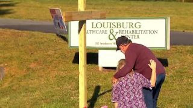 Dozens of people lined up for a drive-by vigil on April 16 for residents of the Louisburg Healthcare & Rehabilitation Center who lost their lives to COVID-19.