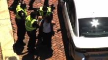 IMAGES: At least four protesters arrested in Raleigh, one the ReOpenNC organizer