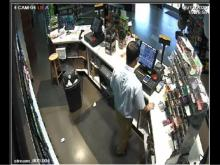 Surveillance video shows man robbing gas station clerk before fatal officer-involved shooting