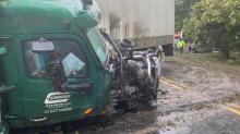 IMAGES: SUV runs stop sign, is struck by tractor-trailer