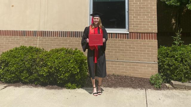 Sarah Barnes celebrates her graduation outside of Salem Middle School