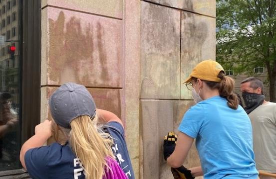 Volunteers clean up graffiti in downtown Raleigh