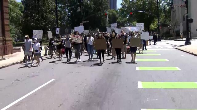 Hundreds of people marched and chanted on and around the grounds of the State Capitol.