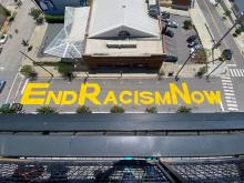 Protesters paint 'end racism now' on Martin Street in downtown Raleigh.