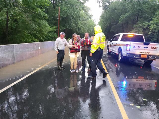 Two people rescued by Nash County crews after driving through flood waters.