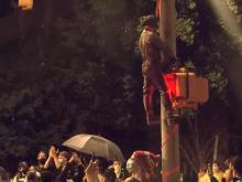 Confederate statue hung from light fixture in downtown Raleigh