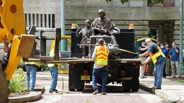Two confederte statues are loaded up on a flat bed truck and removed from downtown Raleigh. Friday night, protesters removed two confederate statues from downtown.