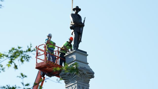 Crews work to remove the Confederate soldier statue was taken down at the State Capitol