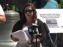 Ashley Smith, leader of ReOpenNC, holds a press conference near the Liberty Bell in downtown Raleigh.