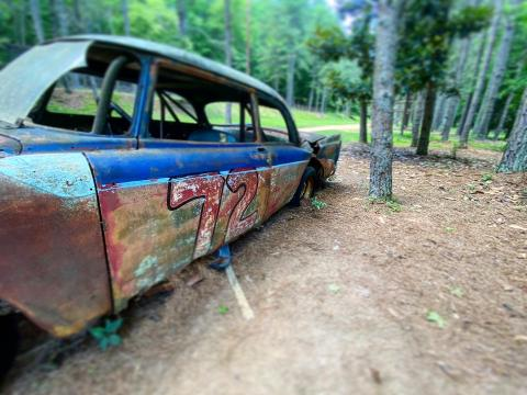 Rusted race cars can still be found in the woods by Occoneechee Speedway.