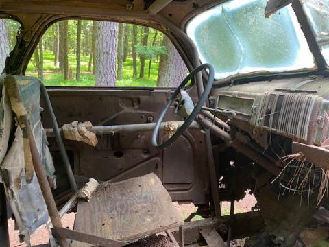 A peek inside the rusted-out stock car abandoned in the woods.