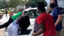 IMAGES: Driver who had protesters jump on her car, block her path criticizes Raleigh police, protesters