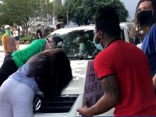 Protesters block car on Blount Street