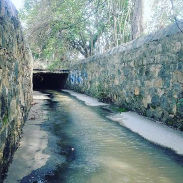Antique cobblestone aqueduct that runs beneath Devereux Meadow