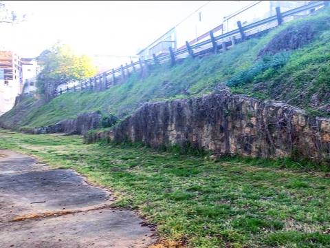 The stone wall and steep incline likely shows the shape of where the stadium bleachers once sat.
