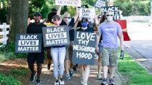 IMAGES: Community caravan protests hateful letter sent to Wakefield Estates family