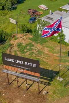 Black Lives Matter sign and Confederate flag