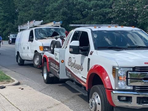 Van crashes through wall of Raleigh apartment