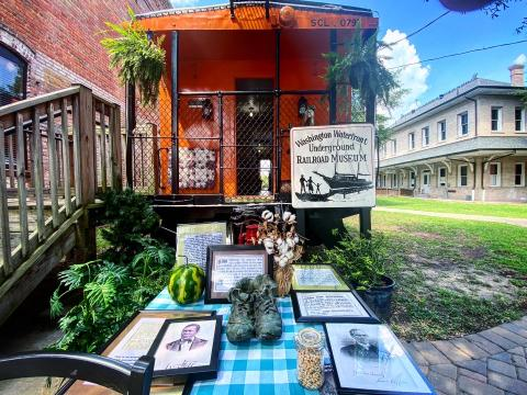This bright orange railroad car is the location of the Washington Waterfront Underground Railroad Museum, which houses relics and stories from the history of the Underground Railroad network in North Carolina.