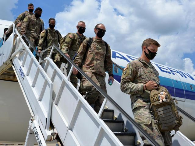 """North Carolina National Guard Soldiers of the30th Armored Brigade Combat Team arrive atRaleigh-Durham International Airport in Raleigh, North Carolina, after a year-longdeployment to the Middle East in support of Operation Inherent Resolve and Operation Spartan Shield July 25, 2020.  """"A special day, the 30th Division honored for World War 2 Presidential Unit Citation ceremony at Headquarters and the first soldiers of the 30th (brigade) comes back home here,""""said North Carolina Army National Guard Brig. Gen. Allen Boyette, NCNG Assistant Adjutant General.  (U.S. Army National Guard photo by Sgt. 1st Class Robert Jordan, 113th Sustainment Brigade/Released)"""