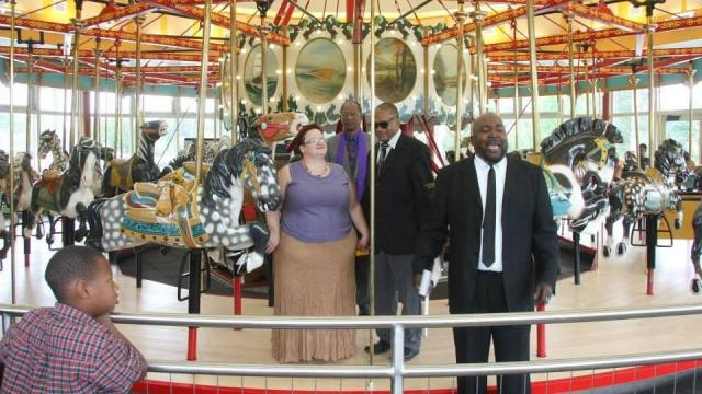 Tim and Lori Truzy had their wedding on the Chavis carousel, symbolic of life's ups and downs, as well as Tim's heritage. Photo by Megan Lyons