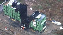IMAGES: Firewall credited with containing fire in Durham townhomes under construction