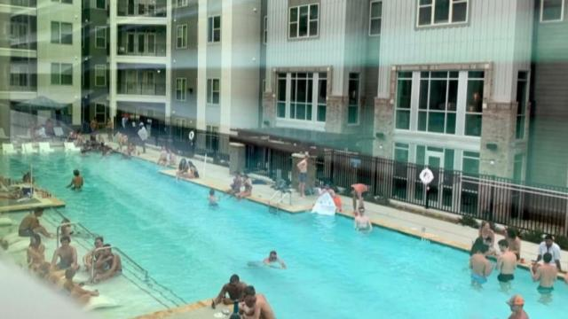 UNC students seen gathering without masks or social distancing at a Chapel Hill pool.