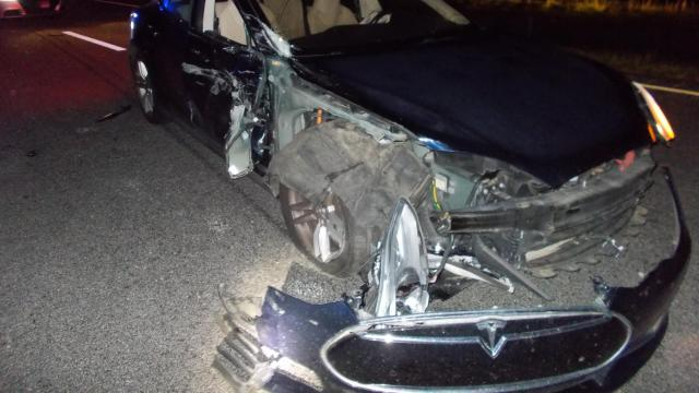 Photo of the Tesla that was crushed during a crash on US Highway 64 on Wednesday. Officials say that the doctor who was driving this car was watching a movie and was driving the car on autopilot mode.