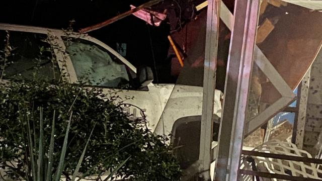 A truck crashed into a home near the intersection of Greenville Avenue and Hinton Avenue Wednesday around 8 p.m.