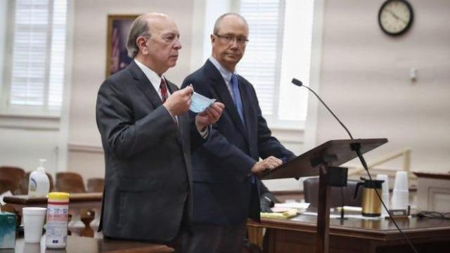 Fayetteville car dealer, Mike Lallier, right, and his lawyer, Paul Cannarella, appear in court Friday in Bennettsville, SC. Photo from Paul Woolverton, Fayetteville Observer.