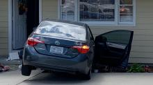 IMAGES: Car crashes into house after police chase on Rock Quarry Road
