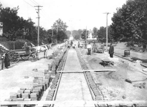 Old photo of streetcar lines being installed. Beneath several Raleigh streets today, old trolley tracks can still be found. (Image courtesy of the State Archives of North Carolina).