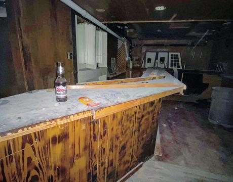 The historic bar has decades of dust covering it.