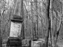 Nathaniel Jones' pillar was tilted precariously, and his wife's box tomb's top was gone.