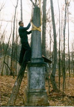 Trying to fix Nathaniel Jones' leaning obelisk.