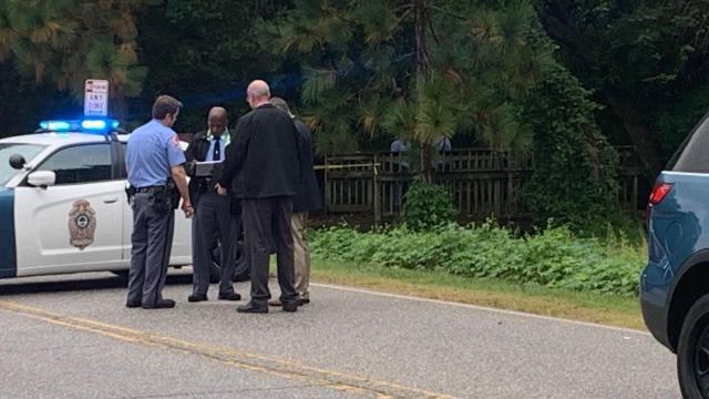 Raleigh police were seen searching under a footbridge