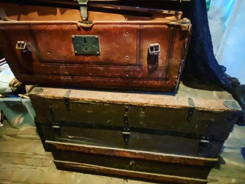 Trunks from the 1800s and early 1900s piled in the attic of Elmwood.