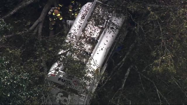 A gasoline tanker crashes in Wake County, causing a leak.