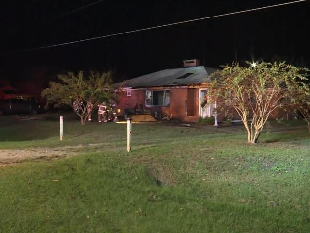 Car crashes into Fayetteville home, starting fire