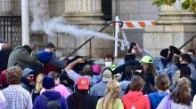 IMAGES: Photos show Alamance sheriff deputies aiming pepper spray just over crowd's faces