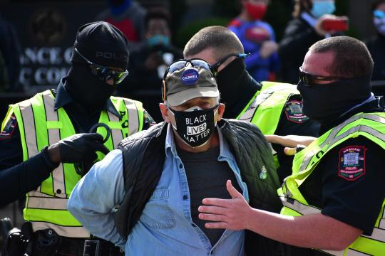 Man with Black Lives Matter mask is being arrested by Graham Police.